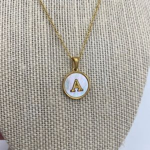 Monogram Delicate medal and chain stainless steel